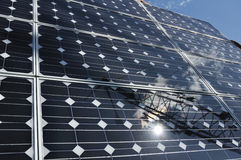 Solar Panel with Reflection of Wind Turbine Royalty Free Stock Photo