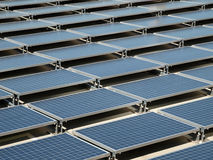 Solar Panel Roof. Shiny, new solar panels on a concrete rooftop Stock Photo