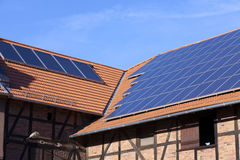 Solar panel on roof. Alternative energy photovoltaic solar panels on the roof of a Agricultural Building Royalty Free Stock Photos