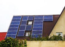 Solar panel on a roof of a house royalty free stock photography