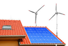 Solar panel on the roof of the house and wind turbines. Stock Photography