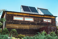 Solar panel on roof of house. Solar panel on roof of wood house Stock Photo