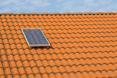 Solar panel on a  roof. Single solar panel on a roof Royalty Free Stock Image