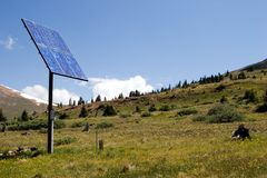 Solar Panel in the Sky I. A solar panel operates efficiently and provides energy high in the mountain meadow Stock Photos