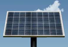 Solar panel. Isolated on a blue sky with clouds Royalty Free Stock Photo