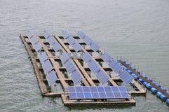 Solar panel station. On the lake Stock Image