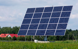 Solar panel station between trees and meadow Stock Photos