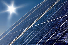 Solar panel and sun. With blue sky Stock Images