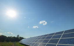 Solar panel and sun. Rural landscape, solar panel and sun Stock Images