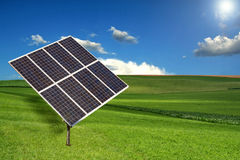 Solar Panel Sun Tracking System. In a Meadow Stock Photo