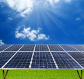 Solar panel with sunlight and clouds on blue sky Stock Photography