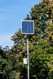 Solar panel supplies street sign and lighting in the city Royalty Free Stock Photo