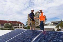 Solar panel technician and client Royalty Free Stock Images