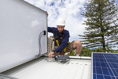 Solar panel technician. Measuring solar output on roof Royalty Free Stock Image