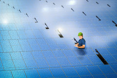 Solar panel technician with solar panel station Royalty Free Stock Photo