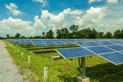 The solar panel tracking systems is very clean, solar cell in Thailand. The solar panel tracking systems with the very clouds and very blue sky in Thailand Stock Photography