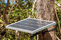 Solar Panel with tree background Royalty Free Stock Images