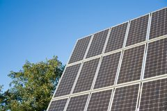 Solar panel and tree Royalty Free Stock Photography