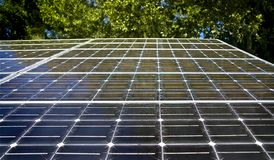 Solar panel with trees on a background. Stock Images