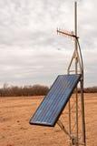 Solar Panel and UHF Antenna. Solar panel powering a uhf radio Stock Image