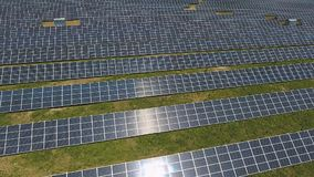 Solar panel units producing renewable energy. Aerial shot stock video footage