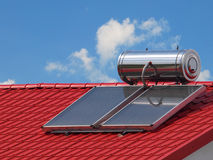 Solar panel used to heat water. On a roof Royalty Free Stock Photography