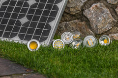 Solar panel and various E27 bulbs, LED, halogen and tungsten bul Royalty Free Stock Photography