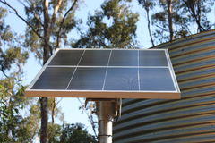 Solar Panel & Water Tank. Solar Panel for electricity generation and Tank for water supply. Together they represent self sufficiency and sustainable living royalty free stock photos