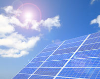 Solar Panel with white cloud and blue sky Royalty Free Stock Images
