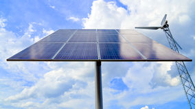 Solar panel and wind turbine Stock Photography