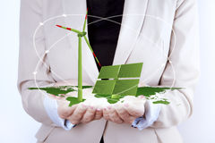 Solar Panel and Wind Turbine in women's hands Royalty Free Stock Photography