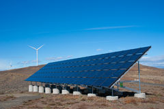 Solar panel and wind turbines Stock Photo