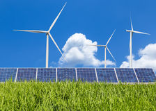 Solar panel and wind turbines renewable green energy in rice field Stock Photography
