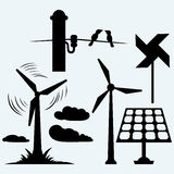 Solar panel and windmill, wires on a pole. Isolated on blue background. Vector silhouettes Royalty Free Stock Photos