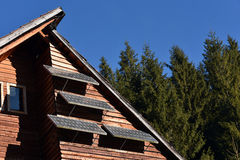 Solar panel on a wooden house Royalty Free Stock Images