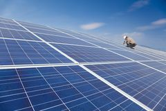 Solar panel and  worker installing. Close upsolar panel and professional worker installing  photovoltaic solar panels Royalty Free Stock Photos