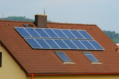 Solar panels. Some solar panels on red home roof Stock Photo