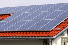 Solar panels. Some solar panels on red home roof Stock Image
