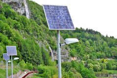 Solar panels. To produce electricity using the sun's rays to illuminate the mountain road royalty free stock images