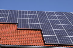 Solar Panels. Roof-mounted solar panels on a domestic house Stock Photo