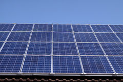 Solar Panels. Roof-mounted solar panels on a domestic house Stock Photography