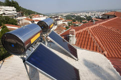Solar panels. On roofs in greek city Stock Photo
