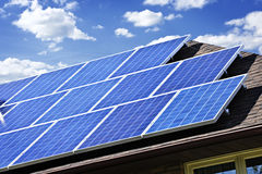 Solar panels. Array of alternative energy photovoltaic solar panels on roof Stock Images