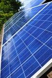 Solar panels. Array of alternative energy photovoltaic solar panels on roof Stock Photo