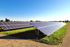 Solar panels. Rows of solars panels in a field on a bright sunny day Stock Photos