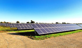 Solar panels. Rows of solars panels in a field on a bright sunny day Stock Photography
