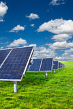 Solar panels. On green grass with blue sky Stock Images
