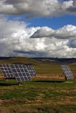 Solar Panels. In a pasture with cows and cloudy sky Stock Photos