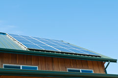 Solar Panels. Close up of solar panels on roof of building. Blue sky. Horizontal. Copy space Royalty Free Stock Images