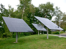 Solar Panels. A group of solar panels at a business near a parking lot royalty free stock images